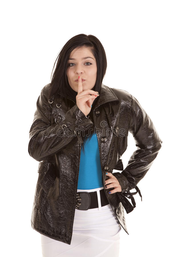 Secret teen jacket. A teen who has a secret with her finger up to her lips royalty free stock image