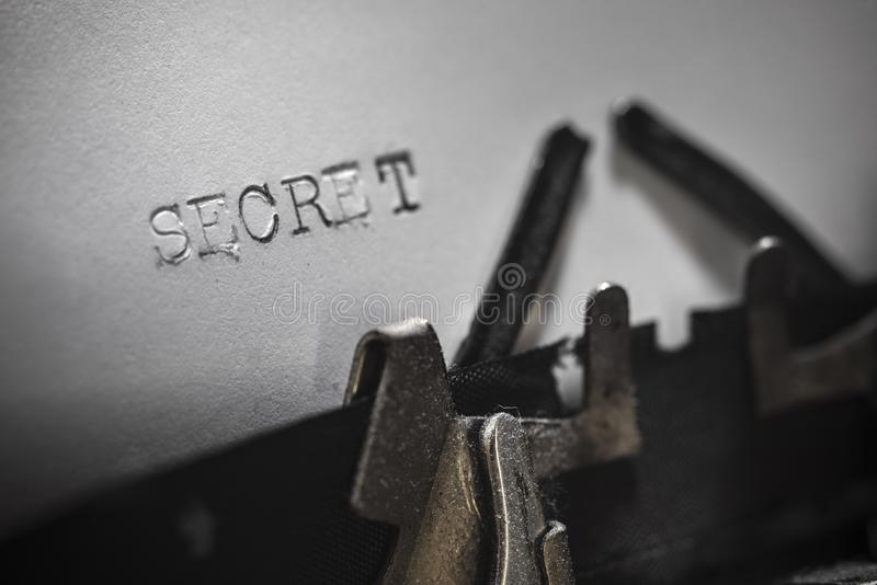 SECRET typed words on a Vintage Typewriter stock images