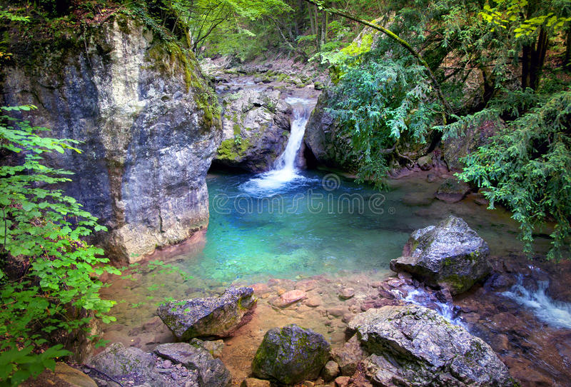 Secret waterfall in a jungle stock images