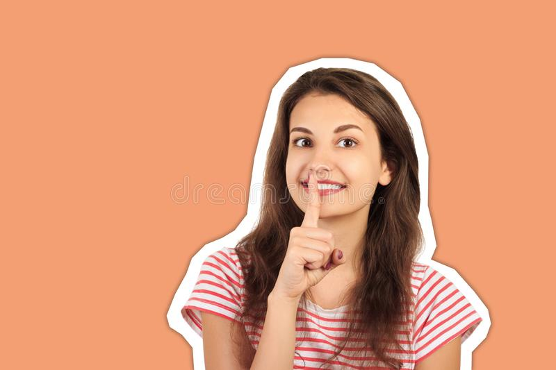 Secret woman. Smiling female showing hand silence sign. emotional girl Magazine collage style with trendy color background royalty free stock photos