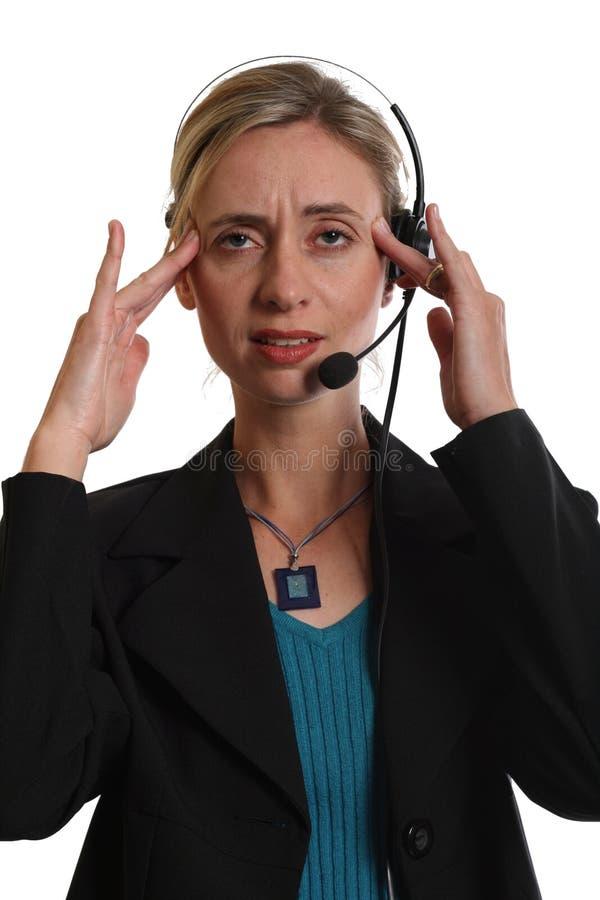 Secretaresse met hoofdpijn stock foto