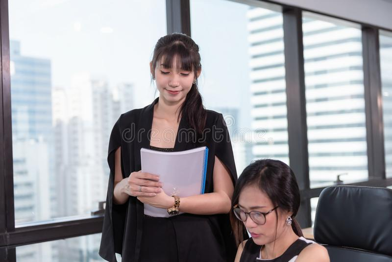 Secretary Assistant Woman is Offering Business Execution of Contract Agreement For Her Manager in Office Workplace. Business royalty free stock photography