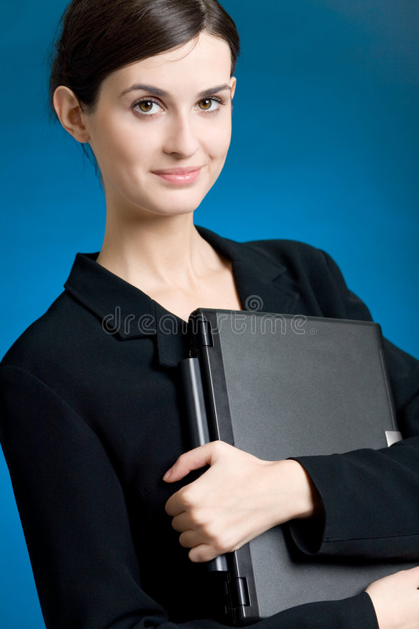 Secretary or businesswoman in suit with notebook on blue background royalty free stock image
