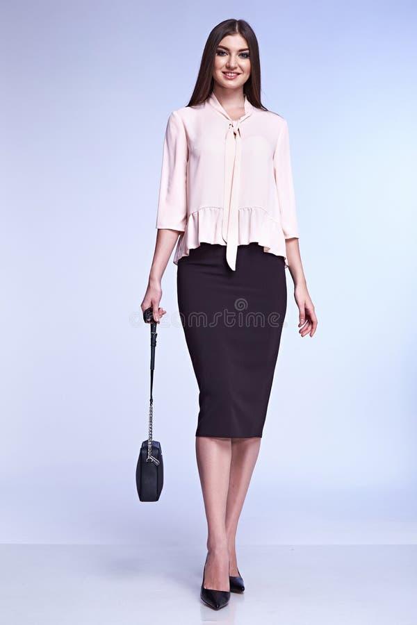 Secretary diplomatic protocol office uniform accessory bag. Business lady beautiful woman model fashion style dress perfect body shape brunette hair wear casual stock image