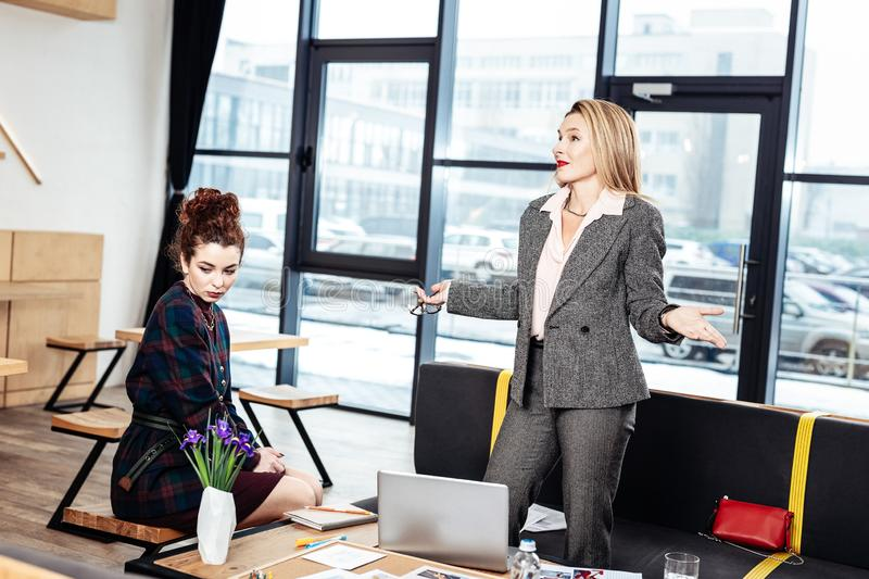 Secretary feeling ashamed after not following instructions stock images