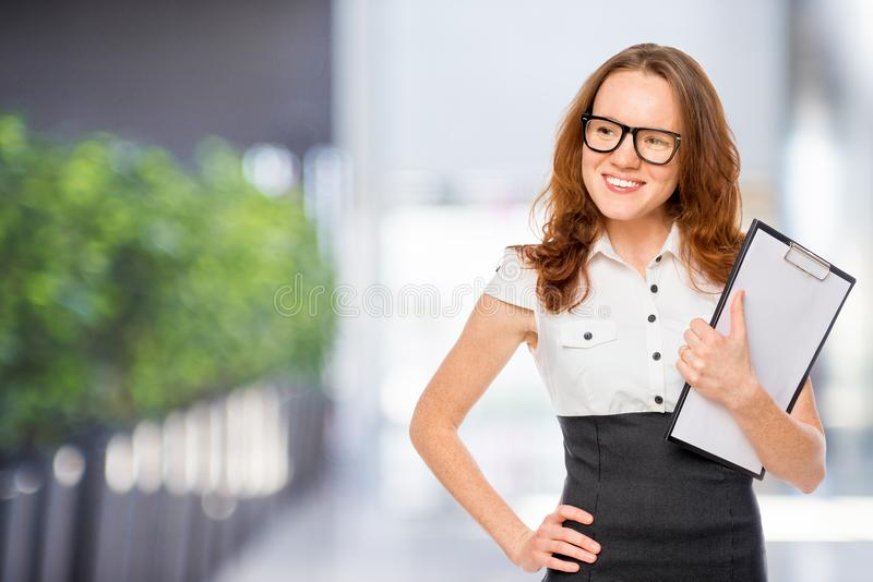 Secretary with folder looking to the left royalty free stock photography