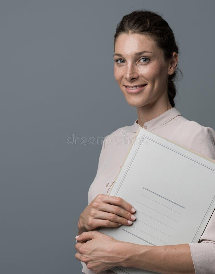 Secretary holding a folder stock image