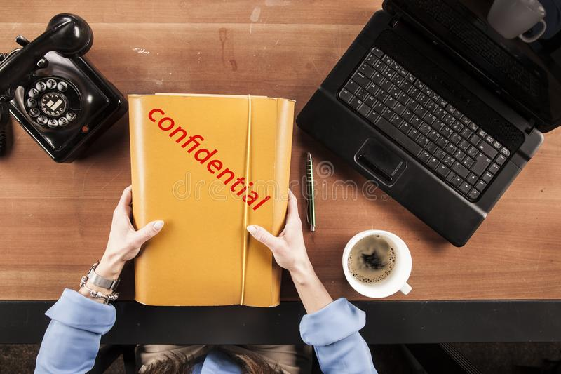 The secretary holds in his hands confidential documents, view fr royalty free stock images