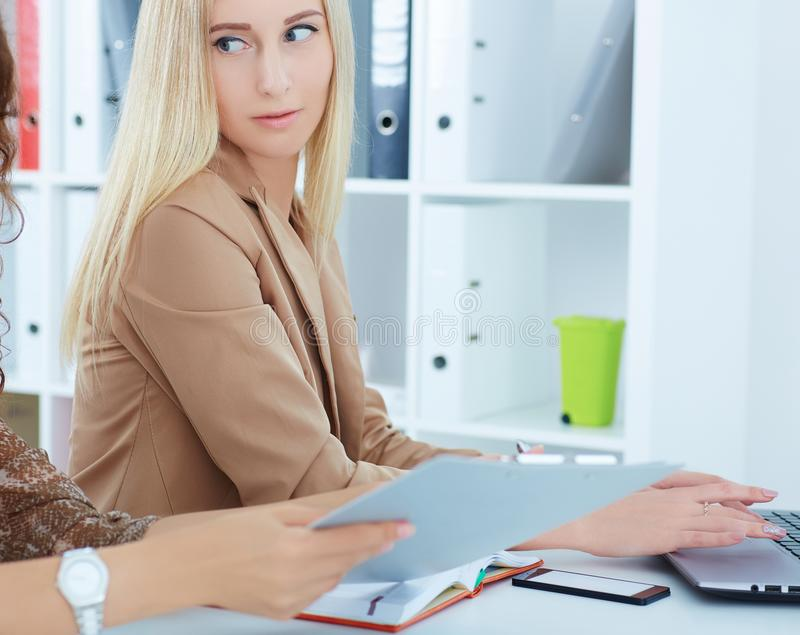 Secretary at the reception of the woman director. Serious business and partnership, conference, job offer, financial stock image