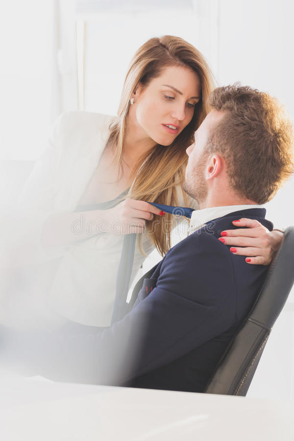 Secretary seducing her boss royalty free stock image
