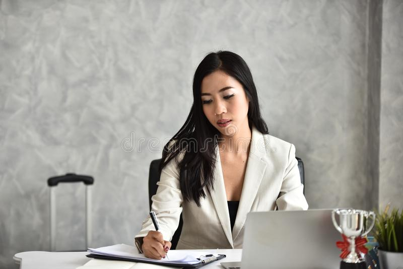 The secretary or staff or accounting officer. At her desk stock photo