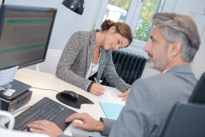 Secretary taking notes from businessman. Personal stock photos