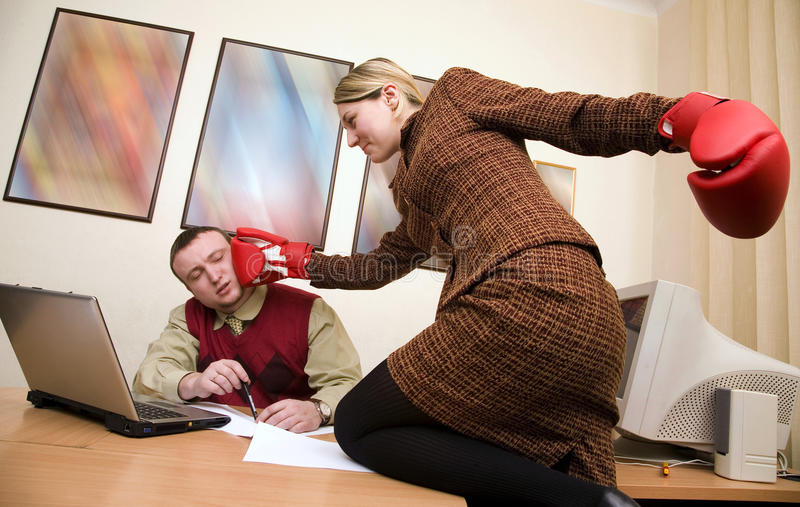 Secretary try to impact on the businessman. Young secretary try to impact on the young businessman royalty free stock images
