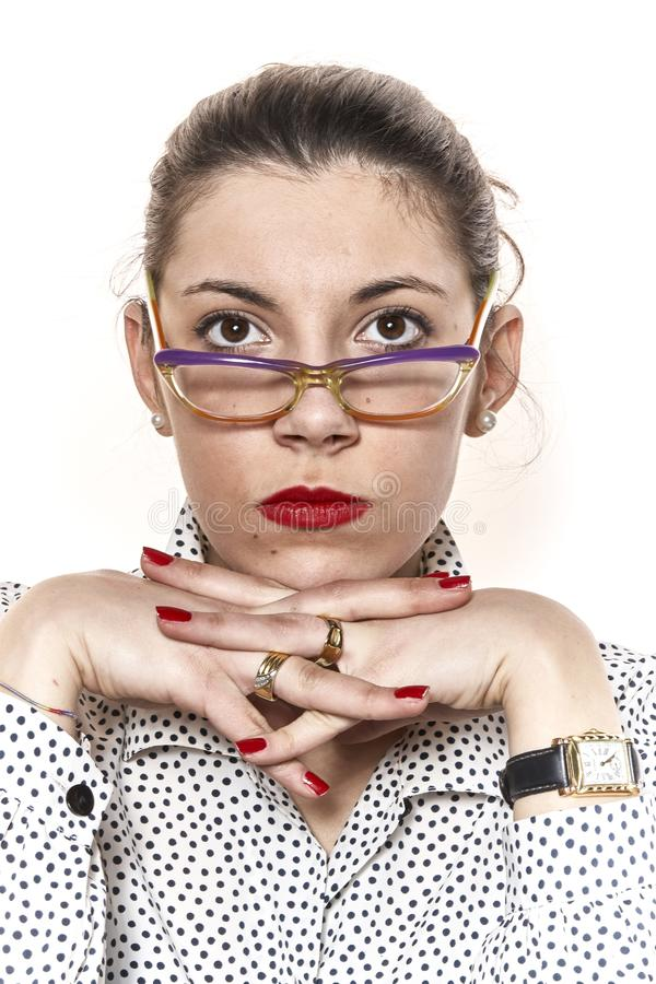 Portrait of a secretary, or a teacher, crosses her fingers stock photography