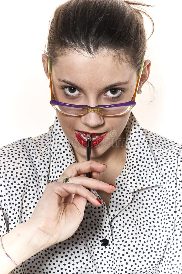 Portrait of a secretary, or a teacher, with a vintage typewriter. Portrait of a secretary or a teacher with glasses and red nails with a vintage typewriter stock photos
