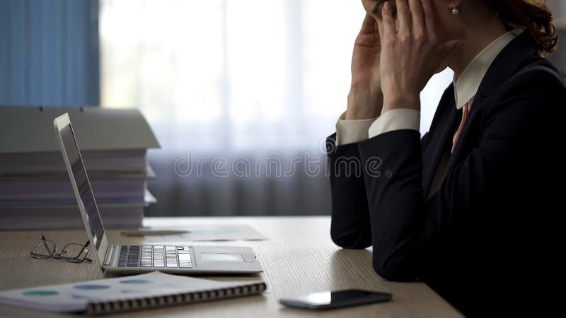 Secretary working hard and making gross error, lady suffering from headache stock images