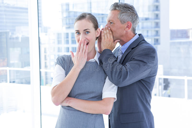 Secretive business colleagues whispering royalty free stock photos