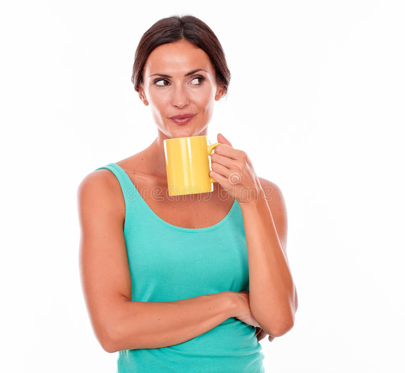 Secretive smiling brunette with coffee mug royalty free stock photography