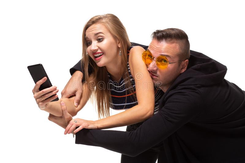 Secretly listening to conversation over phone or peeping social posts, messages. Couple relationship concept. Secretly listening to conversation over phone or stock images