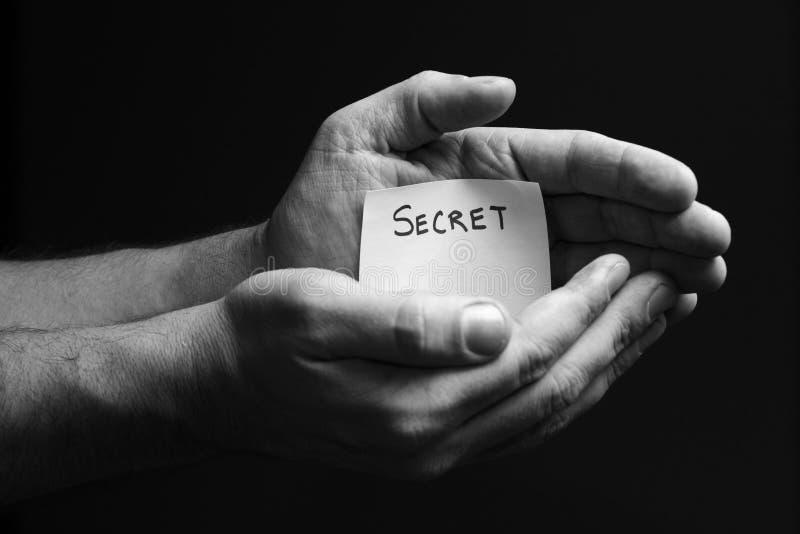 Secreto de la mano imagen de archivo