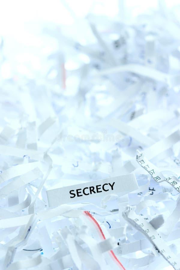 Secreto escrito en el papel destrozado imagen de archivo