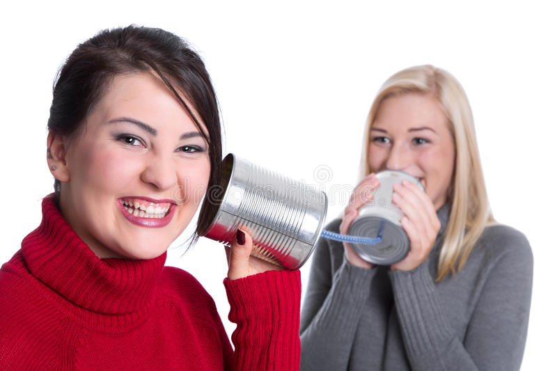 Secrets under girlfriends - two girls talk together and have fun stock photos