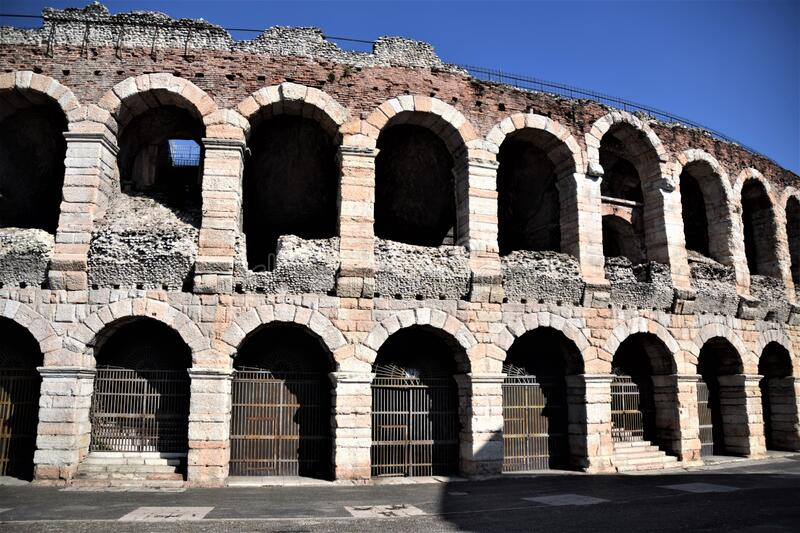 Section of the ancient walls, illuminated by the sun, built in blocks of stone and brick, of the arena of Verona. royalty free stock image