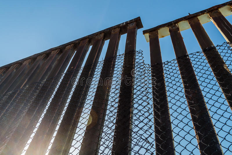 Section of Border Fence Separating the US and Mexico. A section of the border fence separating San Diego, California and Tijuana, Mexico stock image