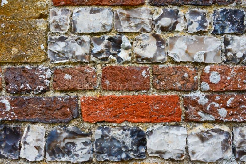 Section de mur de brique et de stgone avec la texture et la couleur photo stock