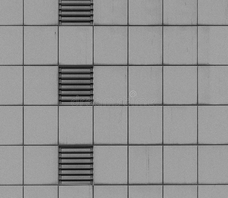 Section of the facade of a high-rise building with mirrored walls.  royalty free stock photography
