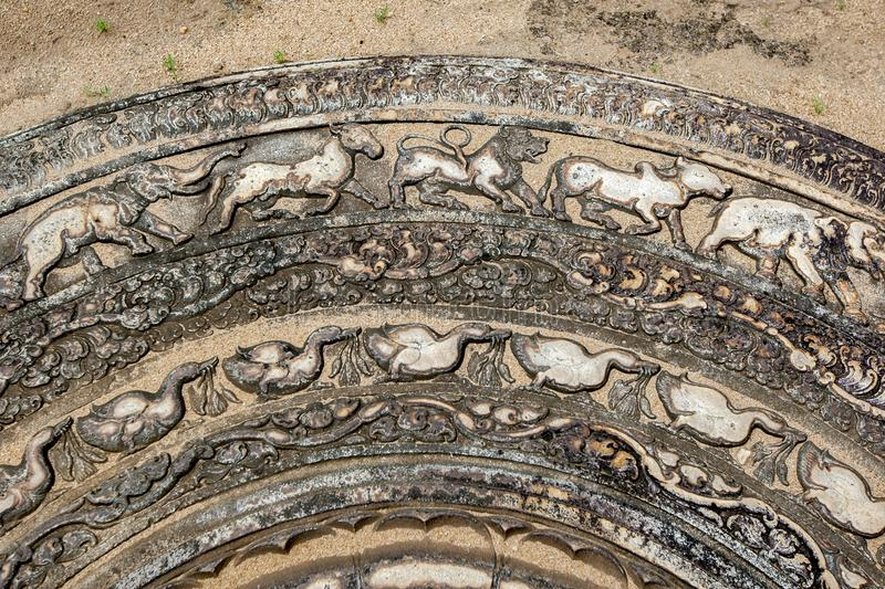 A section of the famous stone moonstone at the ancient ruins of Anuradhapura in Sri Lanka. stock image