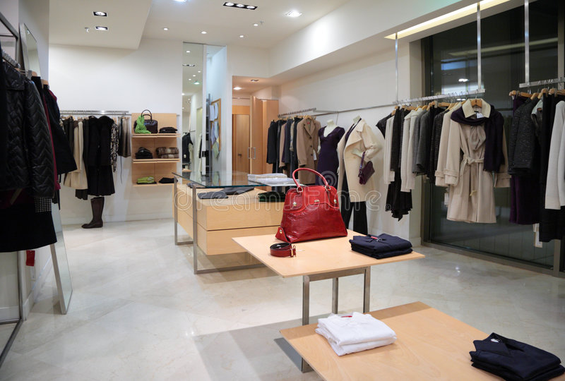 Section of female outer clothing in shop. Section of female outer clothing in modern shop stock image