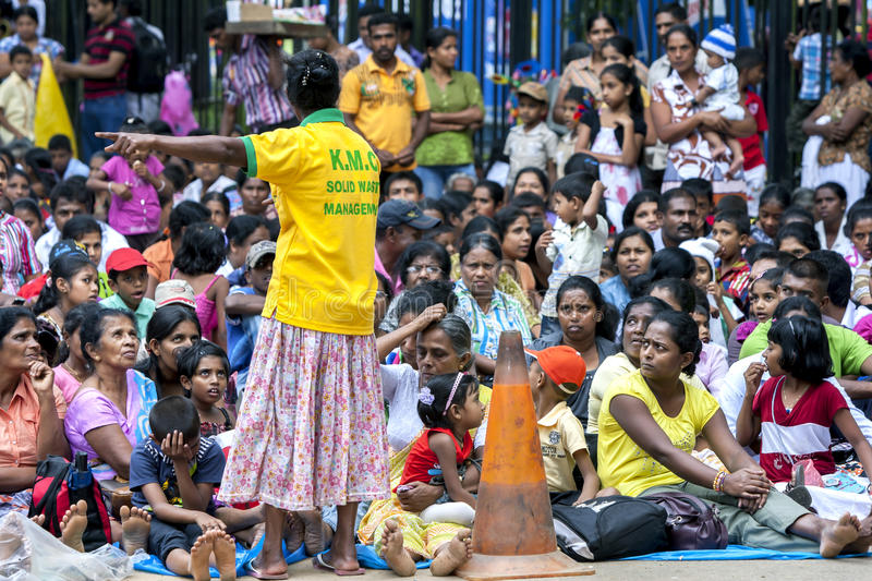 A section of the huge crowd gathered to watch the Esala Perahera in Kandy, Sri Lanka. Many spectators will arrive hours before the Perahera to get a good royalty free stock photography