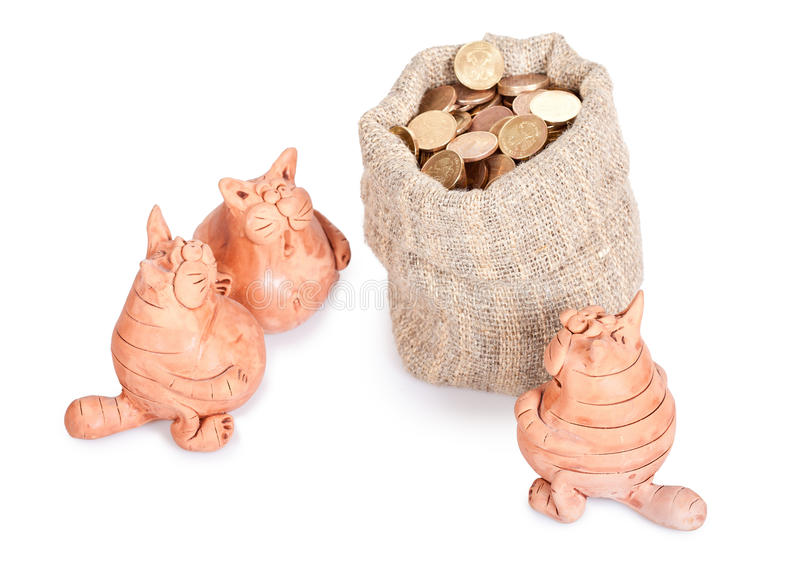 Section of the inheritance. Three cats stand near to a bag of money. Section of the inheritance stock photos