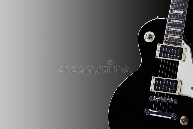 Section of an old black electric guitar body with copy space. A section of an old black electric guitar body with copy space stock image
