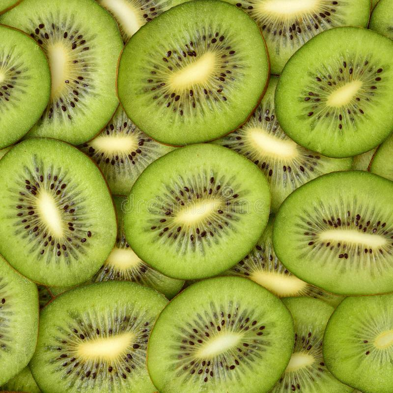 Section slices of kiwi. Lot of cross section slices of kiwi on a heap, top view stock image