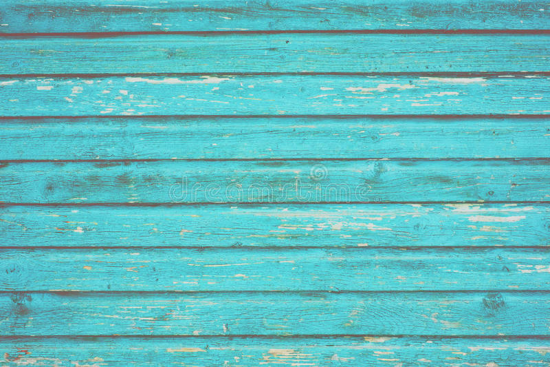 Section of turquoise blue wood panelling from a seaside beach hut. Perfect as a background for Summer Holiday or seaside themes royalty free stock photos