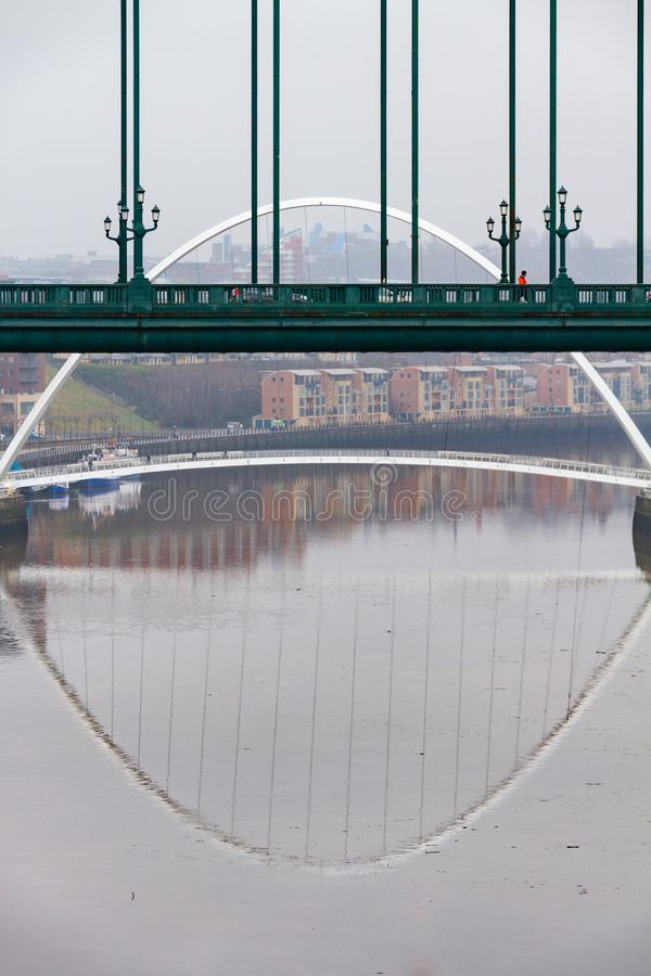Section of the Tyne Bridge in the foreground and Millenium Bridge in the distance at Newcastle Quayside in portrait. Section of the Tyne Bridge in the foreground stock images