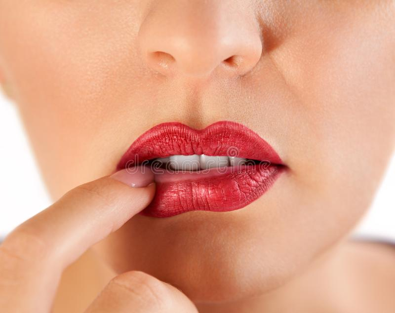 Secuctive red lips of a woman royalty free stock image