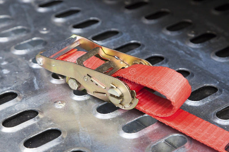 Secure truck load belt. Closeup of a secure truck load belt stock image