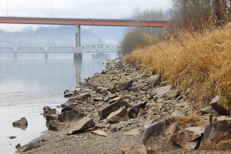 Securing the Riverbank. Small rocks are used to enforce the riverbank and prevent erosion during heavy rains royalty free stock photos