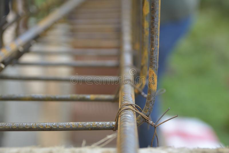 Securing steel bars with wire rod for reinforcement of concrete or cement. stock photos