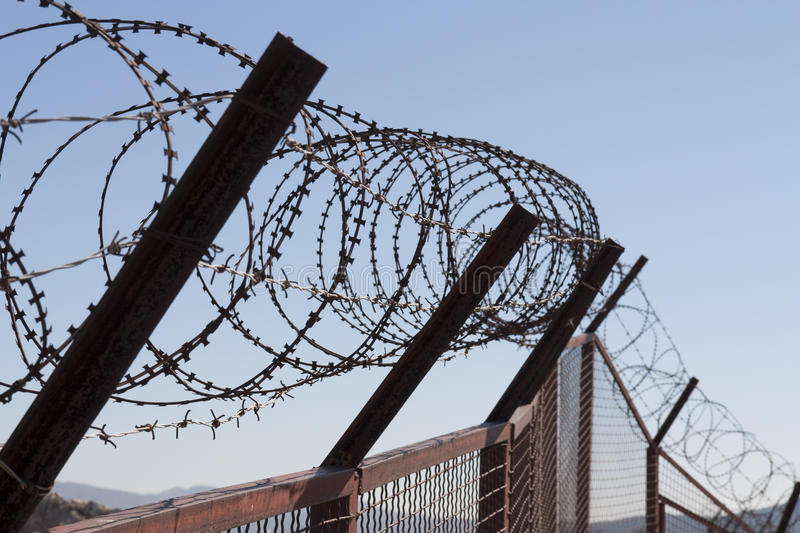 Security With A Barbed Wire Fence. Protection Concept Design. Stock ...