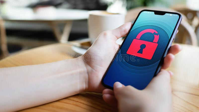 Security breach unlock padlock icon on mobile phone screen. Cyber protection concept. Security breach unlock padlock icon on mobile phone screen. Cyber royalty free stock image