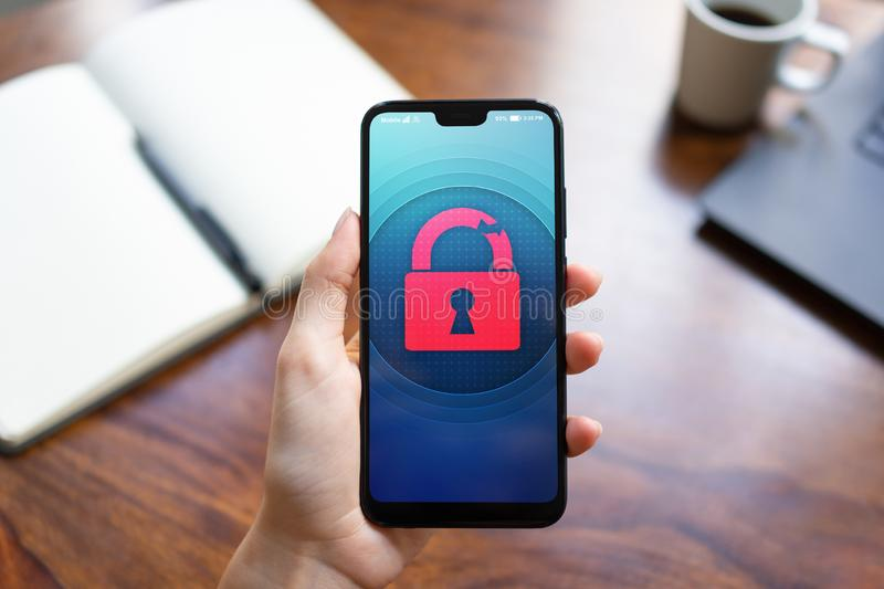 Security breach unlock padlock icon on mobile phone screen. Cyber protection concept. stock image