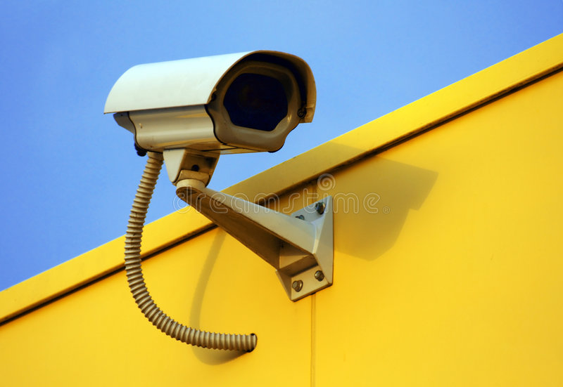 Security cam. Outdoor security camera watching you royalty free stock images