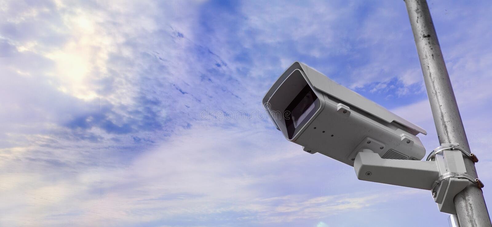 Security camera against dramatic sky. stock images