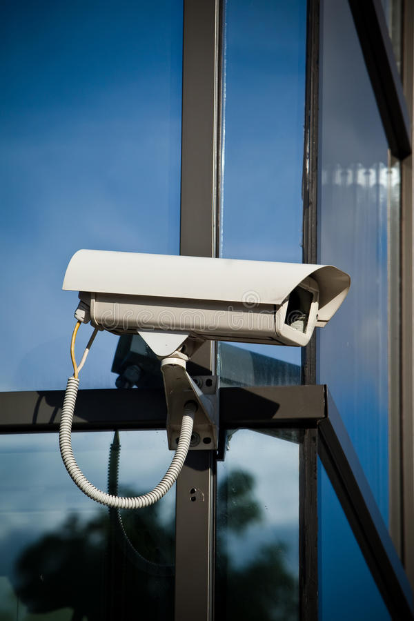 Security camera attached on building stock photography