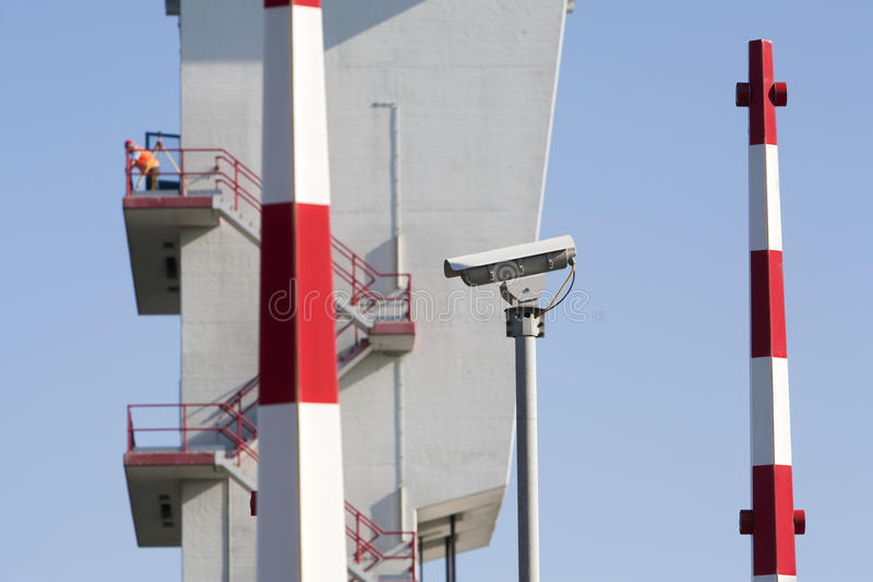 Security camera. Barriers and a worker (out of focus) on top of the tower of the storm surge barrier in Krimpen aan den IJssel, the Netherlands The storm surge stock image