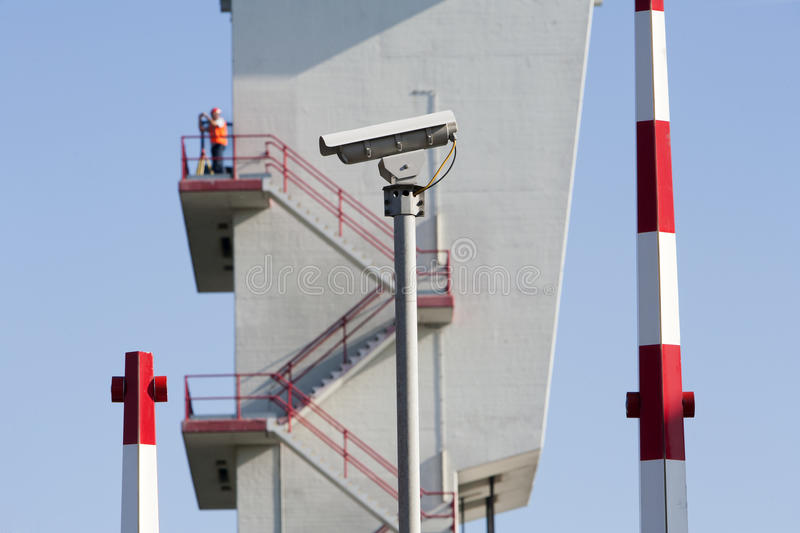 Security camera. Barriers and a worker (out of focus) on top of the tower of the storm surge barrier in Krimpen aan den IJssel, the Netherlands The storm surge royalty free stock photography